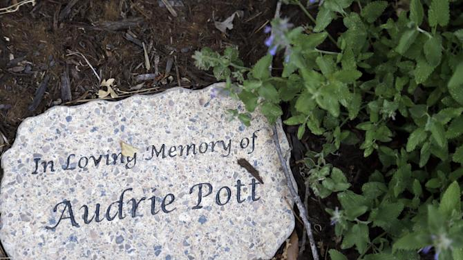 A sign in remembrance of Audrie Pott is seen at her home in Saratoga, Calif., Wednesday, May 22, 2013. Audrie Pott committed suicide in September 2012 after being sexually assaulted by three boys during a house party in Saratoga. Photos of the incident were circulated around Pott's high school prompting the teenager to hang herself in a bathroom at home. (AP Photo/Marcio Jose Sanchez)