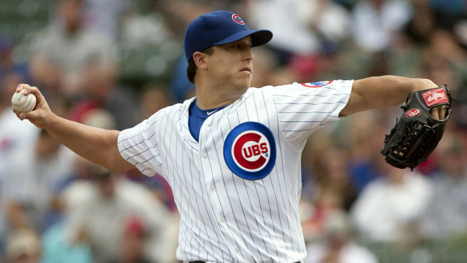 Chicago Cubs starter Jason Berken pitches to the Cincinnati Reds during the first inning of a baseball game in Chicago on Thursday, Sept. 20, 2012. (AP Photo/Charles Cherney)