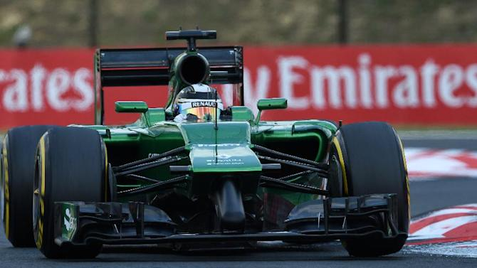 Caterham's Japanese driver Kamui Kobayashi drives during a practice session for the Hungarian Formula One Grand Prix at the Hungaroring circuit in Budapest on July 26, 2014