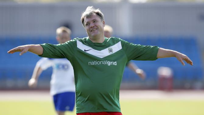 Britain's shadow chancellor Ed Balls reacts during the Labour Party versus the media soccer match, ahead of Labour's annual conference in Manchester