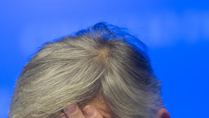 Luxembourg's Prime Minister and President of the eurogroup Jean-Claude Juncker holds his head in his hands before answering questions during a media conference after a meeting of eurogroup finance ministers in Brussels on Tuesday, Nov. 27, 2012. The 17 European Union nations that use the euro have struck an agreement with the International Monetary Fund on a program to reduce Greek debt and put Athens on the way to get the next installment of its much-needed bailout loans. (AP Photo/Jock Fistick, Pool)
