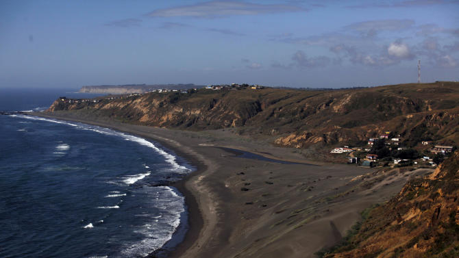 In this photo taken Nov. 29, 2012, the waters of La Boca hug the coast of Navidad, Chile. A magnitude 9.5, the strongest ever recorded in the world, occurred here in 1960. More than 5,000 people were killed after it unleashed tidal waves and sparked the eruption of a volcano. (AP Photo/Luis Hidalgo)