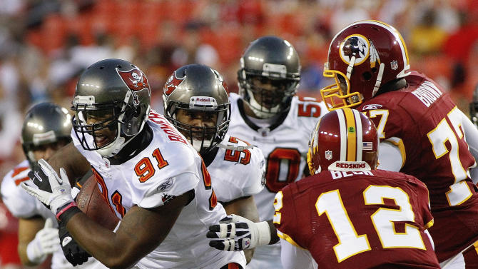 Tampa Bay Buccaneers defensive end Da'Quan Bowers (91) runs with the ball after scoping up a fumble by Washington Redskins running back Evan Royster as Washington Redskins quarterback John Beck and tackle Jammal Brown (77) reach to stop him during the first half of an NFL preseason football game in Landover, Md., on Thursday, Sept. 1, 2011.  (AP Photo/J. David Ake)