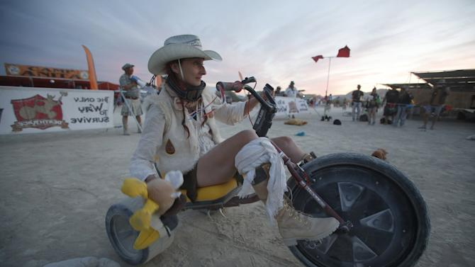 "Sandy Peach competes in the Carnival of Death Race on High Rollers during the Burning Man 2015 ""Carnival of Mirrors"" arts and music festival in the Black Rock Desert of Nevada"