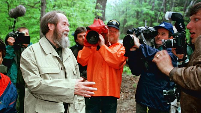 FILE - In this May 24, 1994 file photo, Alexander Solzhenitsyn jokes with the media as he leaves his long-time home in Cavendish, Vt. to return to his native Russia. Residents of a Vermont town that was the home of the exiled former Soviet dissident author have decided to create an exhibit honoring him. Voters at the Town Meeting in Cavendish on Monday, March 4, 2013 overwhelmingly decided the tiny town should take over a historic stone church to house the Nobel laureate's exhibit. (AP Photo/Toby Talbot, File)