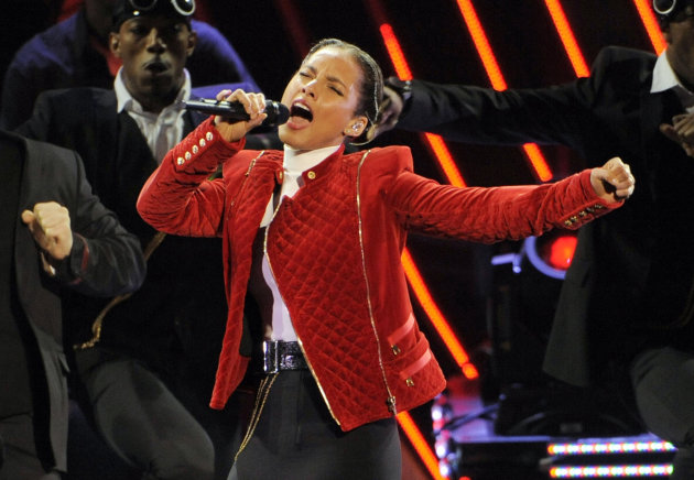 FILE - This Jan. 9, 2013 file photo shows Alicia Keys performing at the People&#39;s Choice Awards in Los Angeles. Keys will perform the national anthem before the NFL championship game on Feb. 3 in New Orleans, a person familiar with Super Bowl entertainment plans told The Associated Press on Friday, Jan. 18. (Photo by Chris Pizzello/Invision/AP, file)