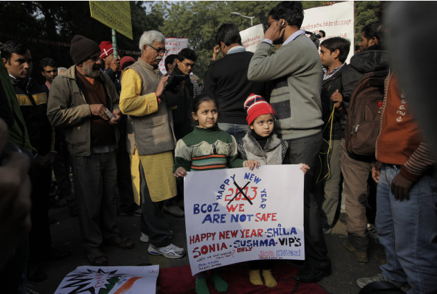 Young Indian girls hold a placard as they participate in a protest in New Delhi, India, Monday, Dec. 31, 2012. The gang-rape and killing of a New Delhi student has set off an impassioned debate about