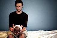 man and newborn