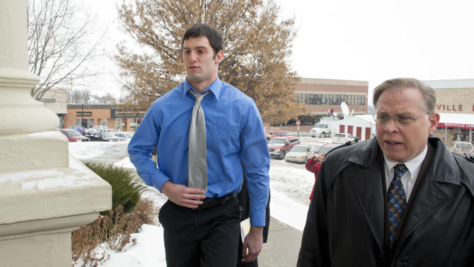Matthew Barnett walks into the courthouse with his legal counsel J.R. Hobbs for a hearing on Thursday, Jan. 9, 2014 in Maryville, Mo. Barnett is accused of sexually assaulting a 14-year-old schoolmate when he was 17 has been charged with misdemeanor child endangerment. Special prosecutor Jean Peters Baker has been re-examining the girl's allegations that Barnett raped her at a January 2012 house party, when he was a Maryville High School senior and she was a freshman. (AP Photo/The Kansas City Star, The Kansas City Star) KANSAS CITY OUT