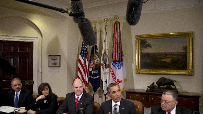 President Barack Obama speaks to media as he meets with representatives from Major Cities Chiefs Association and Major County Sheriffs Association in the Roosevelt Room of the White House, Monday, Jan. 28, 2013, in Washington, to discuss policies put forward by President Obama to reduce gun violence. From left are U.S. Attorney General Eric Holder, Minneapolis Police Chief Janee Harteau and Hennepin County Minnesota Sheriff Richard W. Stanek, President Obama, and Charles H. Ramsey Police Commissioner of the Philadelphia Police Department. (AP Photo/Carolyn Kaster)