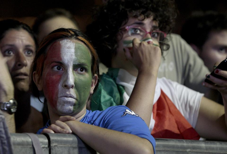 An Italian fan reacts at the Circus Maximus in Rome, during the Euro 2012 soccer championship final match between Italy and Spain, Sunday, July 1, 2012. (AP Photo/Riccardo De Luca)