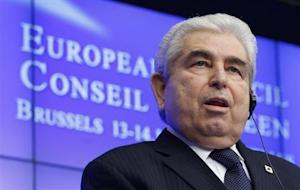 Cyprus' President Christofias addresses a news conference after an EU leaders summit in Brussels