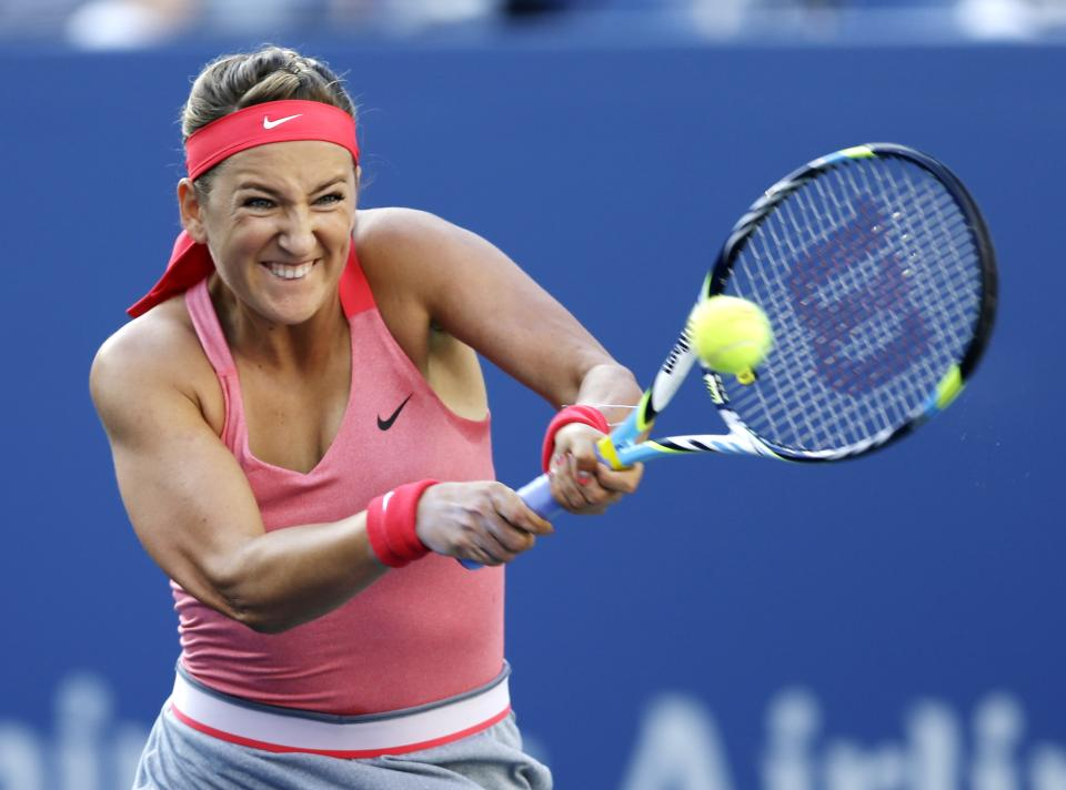 Victoria Azarenka, of Belarus, returns a shot to Serena Williams during the women's singles final of the 2013 U.S. Open tennis tournament, Sunday, Sept. 8, 2013, in New York. (AP Photo/Darron Cummings)