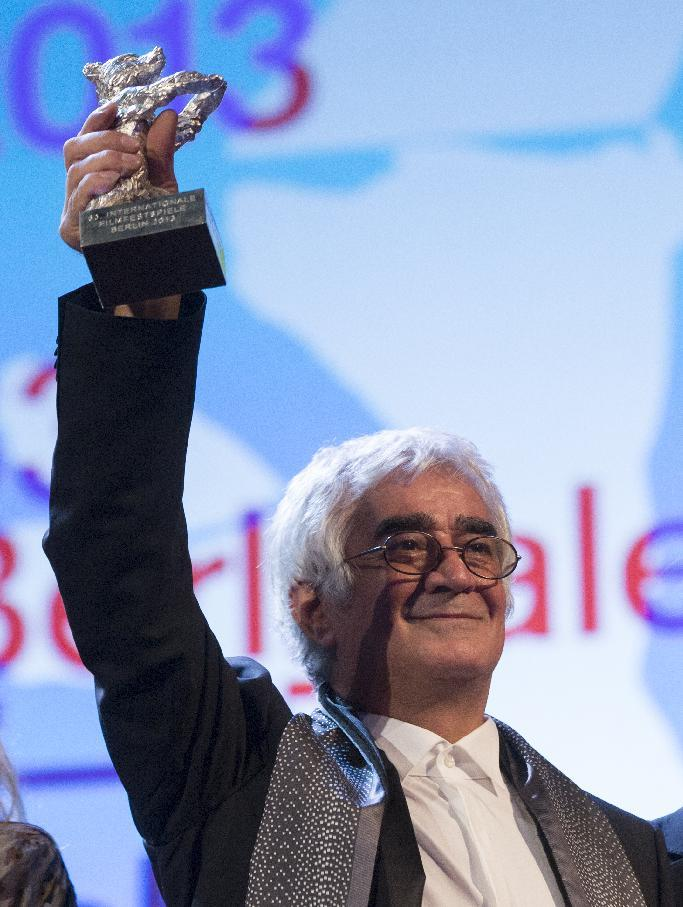 Director Kambuzia Partovi holds the Silver Bear for Best Script for the film Closed Curtain at the closing ceremony at the 63rd edition of the Berlinale, International Film Festival in Berlin, Saturday, Feb. 16, 2013. (AP Photo/Gero Breloer)