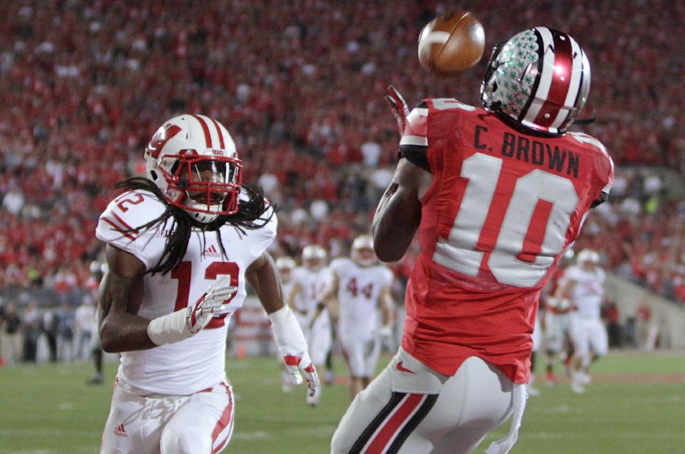 Miller, No. 4 Ohio St beat No. 23 Wisconsin 31-24