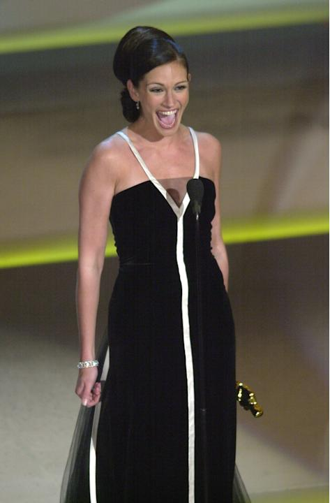 FILE - In this March 25, 2001 file photo, Julia Roberts reacts after winning the Oscar for best actress in a leading role for the film