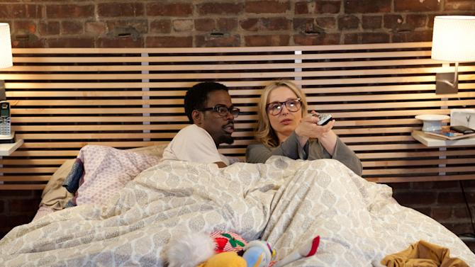 """In this film image released by the Tribeca Film Festival, Chris Rock, left, and Julie Delpy are shown in a scene from """"2 Days in New York,"""" a film that premiered at the Tribeca Film Festival on Thursday, April 26, 2012 in New York. (AP Photo/Tribeca Film Festival, Magnolia Pictures)"""