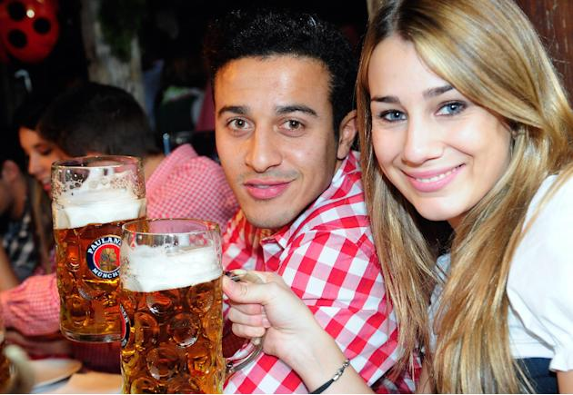Thiago Alcantara of Bayern Muenchen from Spain and his girlfriend Julia Vigas attend the Oktoberfest beer festival in Munich southern Germany, Sunday, Oct 6, 2013