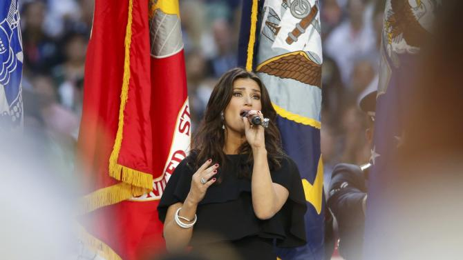 Idina Menzel sings the U.S. National Anthem before the start of the NFL Super Bowl XLIX football game between the Seattle Seahawks and the New England Patriots in Glendale