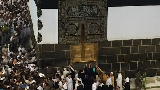 Muslim pilgrims pray at the door of the Kabaa inside the Grand Mosque a day before Muslim's annual pilgrimage, known as the Hajj, in the Muslim holy city of Mecca, Saudi Arabia, Wednesday, Oct. 1, 2014. (AP Photo/Khalid Mohammed)