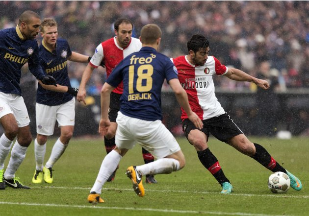 Pelle of Feyenoord Rotterdam scores past Derijck of PSV Eindhoven during their Eredivisie soccer match in Rotterdam