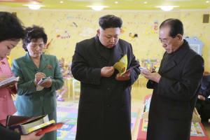 North Korean leader Kim Jong Un checks a book during his visit the Pyongyang Baby Home and Orphanage on New Years Day