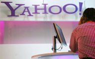 US regulators announced that a former Yahoo! executive has agreed to plead guilty in an insider trading scheme that involved leaking word of the Internet search giant's pact with Microsoft