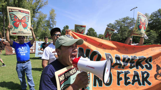 Demonstrators speak during a protest march in Frazier Park, Sunday, Sept. 2, 2012, in Charlotte, N.C. Demonstrators are protesting before the start of the Democratic National Convention. (AP Photo/Chuck Burton)
