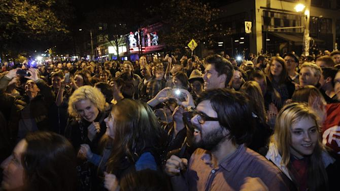 A large crowd of people celebrates at the conclusion of the presidential election in Seattle's Capitol Hill neighborhood, Tuesday, Nov. 6, 2012. The re-election of President Barack Obama and Washington state's referendum 74, which would legalize gay marriage, drew the most supporters to the streets. (AP Photo/Ted S. Warren)