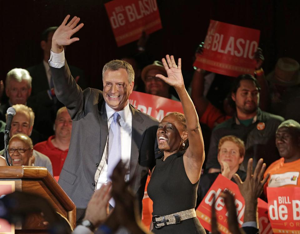 New York City Democratic mayoral hopeful Bill de Blasio celebrates on stage with his wife, Chirlane, right, after addressing supporters at his election headquarters after polls closed in the city's primary election Wednesday, Sept. 11, 2013, in New York. (AP Photo/Kathy Willens)