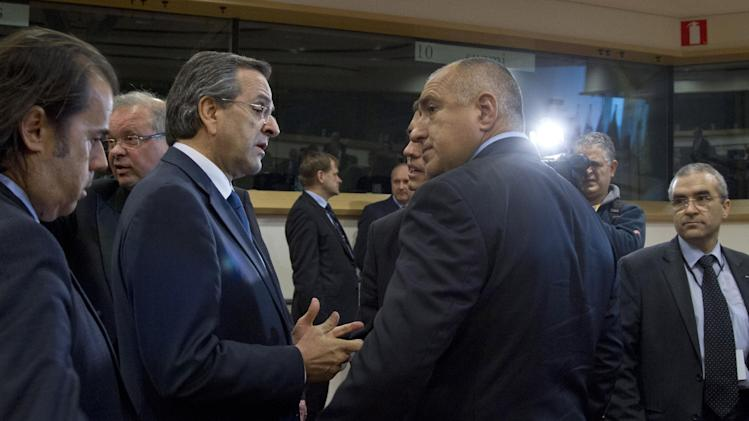 Greek Prime Minister Antonis Samaras, third left, speaks with Bulgaria's Prime Minister Boyko Borissov, third right, during a Friends of Cohesion meeting at the European Parliament in Brussels on Tuesday, Nov. 13, 2012. EU leaders met on Tuesday to discuss tactics ahead of the battle for the EU budget. (AP Photo/Virginia Mayo)