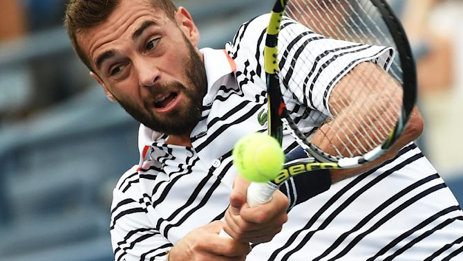 France's Benoit Paire returns a shot to Japan's Kei Nishikori during their US Open men's singles match in New York on August 31, 2015