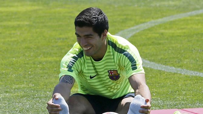 Barcelona's Luis Suarez stretches during a training session during the media Barcelona Open Day ahead of the Champions League final against Juventus