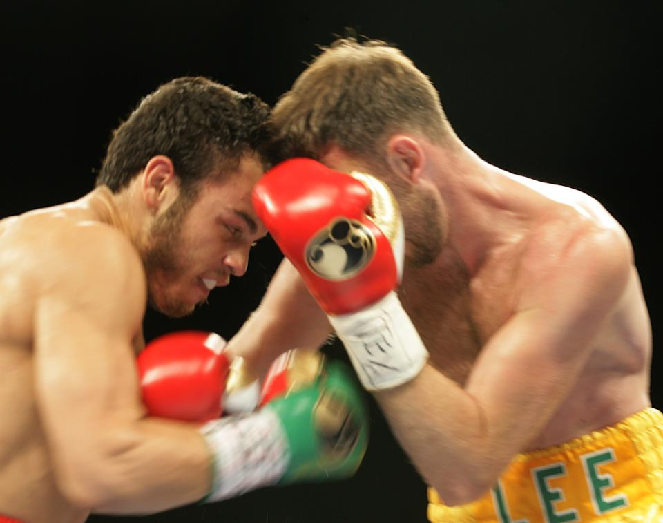 Julio Cesar Chavez Jr., left, throws a right at Andy Lee during their WBC middleweight title bout Saturday, June 16, 2012, in El Paso, Texas. (AP Photo/El Paso Times, Victor Calzada)  EL PASO OUT   JUAREZ, MEXICO, OUT