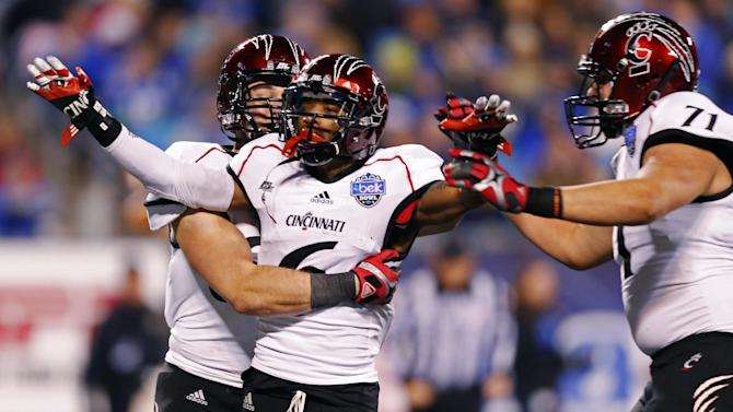 Cincinnati's Anthony McClung (6) reacts with Eric Lefeld (71) after his touchdown against Duke during the first half of the Belk Bowl NCAA college football game in Charlotte, N.C., Thursday, Dec. 27, 2012. (AP Photo/Chuck Burton)