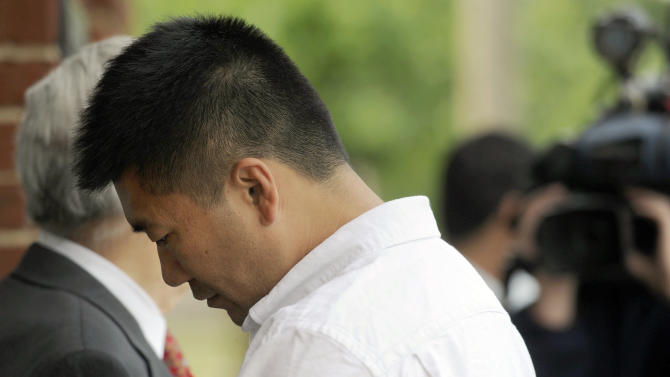 FILE - In this Friday, June 3, 2011 file photo, Kin Yiu Cheung arrives at Caroline County General District court, in Bowling Green Va. Cheung, 37, is scheduled to appear in a Virginia court Wednesday, July 11, 2011 on charges stemming from a May crash on Interstate 95 that killed four passengers. Cheung, of New York City is charged with four felony counts of involuntary manslaughter in the fatal crash about 30 miles north of Richmond. (AP Photo/The Free Lance Star, Reza A. Marvashti, File)  MANDATORY CREDIT