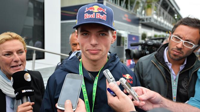 The Dutch teenager sixteen-year-old Max Verstappen talks to the media in the paddock at the Spa-Francorchamps circuit in Spa, Germany on August 22, 2014