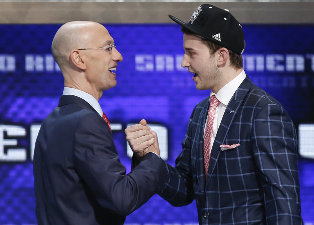 Nik Stauskas + Adam Silver = power daps. (AP/Kathy Willens)