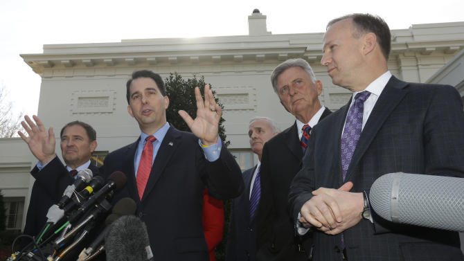 Members of the National Governors Association (NGA) Executive Committee, from left, Utah Gov. Gary Herbert; Wisconsin Gov. Scott Walker; Minnesota Gov. Mark Dayton; Arkansas Gov. Mike Beebe, and Chairman, Delaware Gov. Jack Markell, talk to reporters outside the West Wing of the White House in Washington, Tuesday, Dec. 4, 2012, following their meeting with President Barack Obama regarding the fiscal cliff. (AP Photo/Pablo Martinez Monsivais)