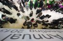 Participants walk inside the Congress Center during the 43rd Annual Meeting of the World Economic Forum, WEF, in Davos, Switzerland, Saturday, Jan. 26, 2013. (AP Photo/Keystone/Jean-Christophe Bott)