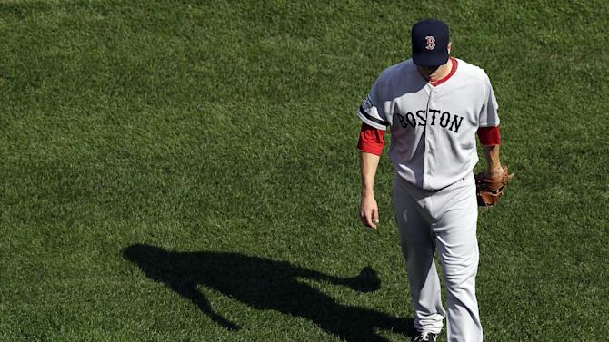 Boston Red Sox starting pitcher Zach Stewart walks off the field after being relieved in the third inning of a baseball game against the Baltimore Orioles in Baltimore, Sunday, Sept. 30, 2012. (AP Photo/Patrick Semansky)