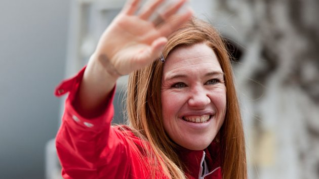 Canadian athlete Clara Hughes waves to fans during the Olympic Heroes Parade.