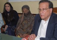 <p>File photo of Christian mother Asia Bibi (C) who sentenced to death for blasphemy in 2010 and then Pakistani Punjab province governor Salman Taseer (R), who assassinated in January 2011 for his opposition to the blasphemy law.</p>