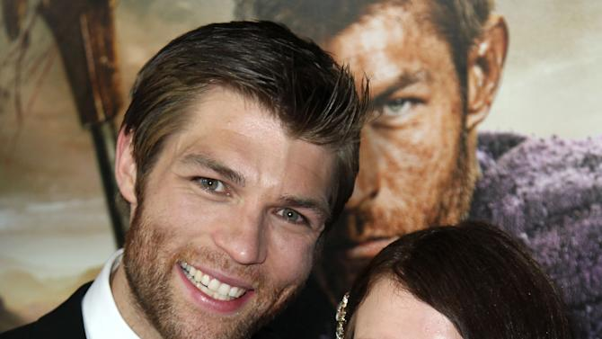 """Liam McIntyre, left, and Erin Hasan arrive at the premiere of """"Spartacus: War of the Damned"""" on Tuesday, Jan. 22, 2013 in Los Angeles. """"Spartacus: War of the Damned"""" premieres Friday, Jan. 25 at 9PM on STARZ. (Photo by Matt Sayles/Invision for STARZ/AP Images)"""