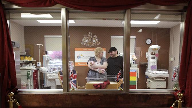 IMAGE DISTRIBUTED FOR HUGGIES: Casilyn Meadows, left, and Damian Waggoner hold their newborn daughter, Ceanna Waggoner, in the royal-themed nursery at Madison Health, Sunday, May 3, 2015, in London, Ohio. Huggies is giving the Madison Health Maternity Center a royal makeover with a red carpet entrance, throne room and royal nursery viewing area. Each baby born this week will also receive a royal gift package including a six month supply of Huggies Little Snugglers Diapers and Huggies Natural Care Wipes. (Jay LaPrete/Huggies via AP Images)