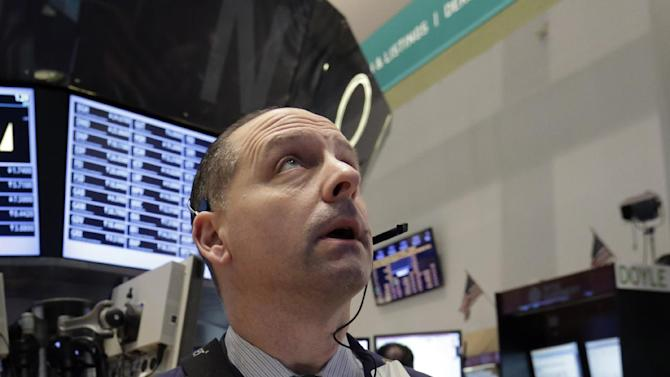 Trader Michael Urkonis works on the floor of the New York Stock Exchange Friday, March 8, 2013. Stocks are opening higher on Wall Street after the government reported a burst of hiring last month that sent the unemployment rate to a four-year low. (AP Photo/Richard Drew)