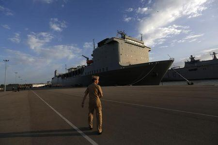 U.S. navy personnel walks near U.S. MV Cape Ray ship docked at the naval airbase in Rota