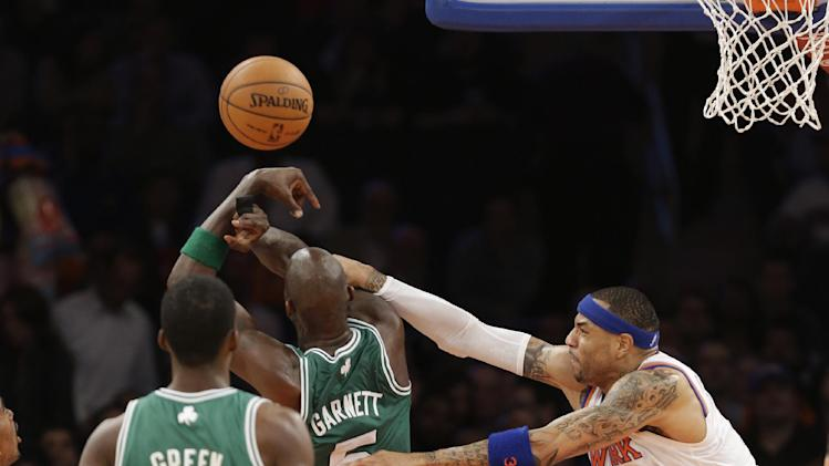 New York Knicks forward Kenyon Martin, right, fouls Boston Celtics center Kevin Garnett (5) in the first half of Game 5 of their first-round NBA basketball playoff series at Madison Square Garden in New York, Wednesday, May 1, 2013. Celtics forward Jeff Green (8) watches the play. (AP Photo/Kathy Willens)