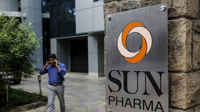 File photo of an employee speaking on phone as he walks out of research and development centre of Sun Pharmaceutical Industries Ltd in Mumbai
