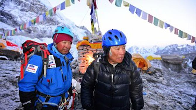In this Thursday, May 16, 2013 photo distributed by Miura Dolphins, 80-year-old Japanese adventurer Yuichiro Miura, right, and his son, Gota, leave their base camp at 5,300 meters (17,388 feet) for their attempt to scale the summit of Mount Everest. According to his management office, Miura plans to accomplish the ascent on Thursday, May 23 to be the world's oldest person to reach the world's highest peak. (AP Photo/Miura Dolphins)  MANDATORY CREDIT